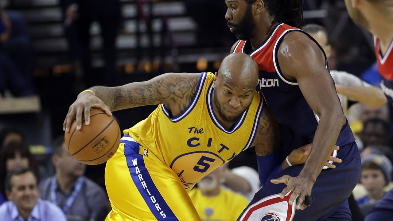 Golden State Warriors Marreese Speights (5) tries to get around Washington Wizards Nene during the first half of an NBA basketball gameMarch 29, 2016, in Oakland, Calif.
