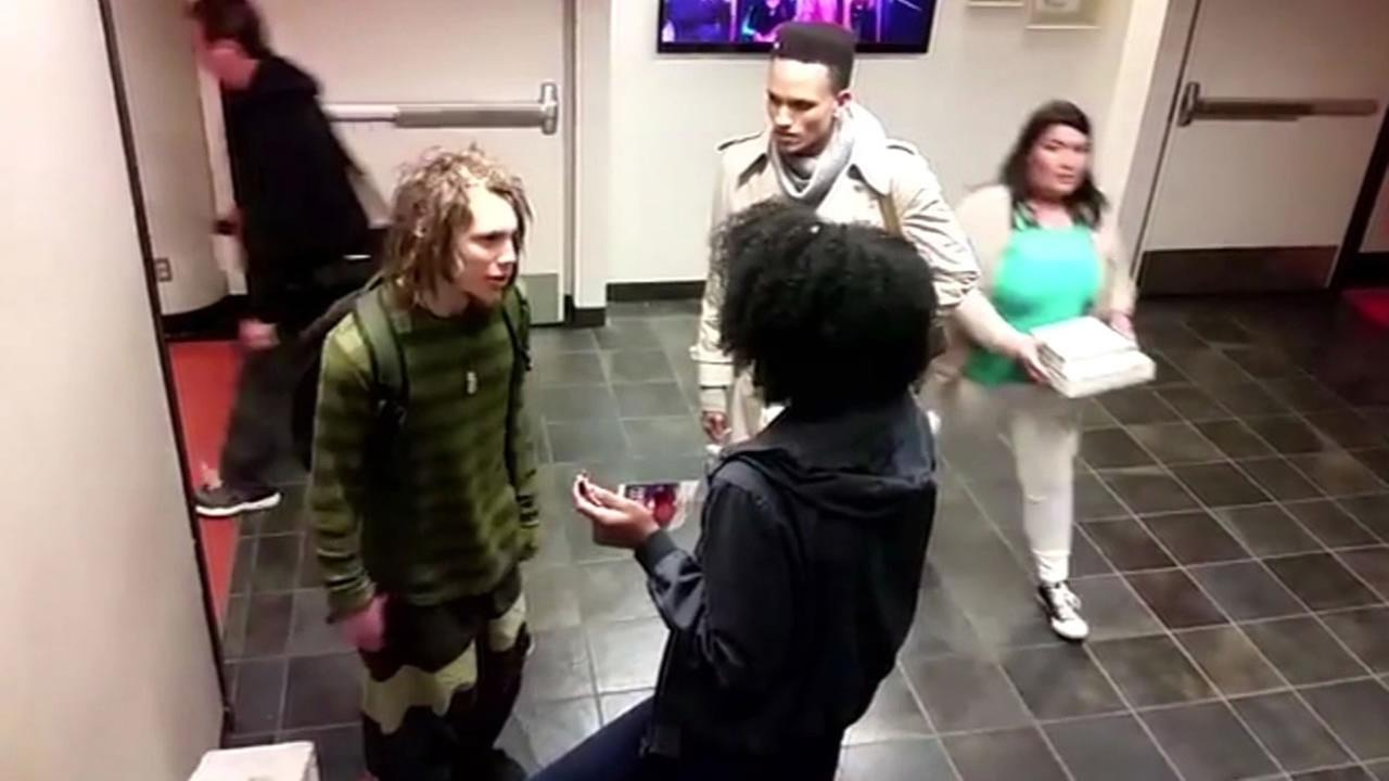 This images is a still from video taken at San Francisco State University showing Corey Goldstein and Bonita engaged in a confrontation over dreadlocks.