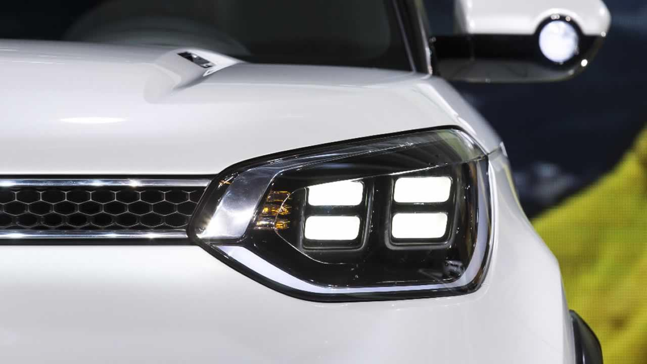 Headlights are shown from a concept car during the media preview of the Chicago Auto Show at McCormick Place in Chicago on Thursday, Feb. 12, 2015.
