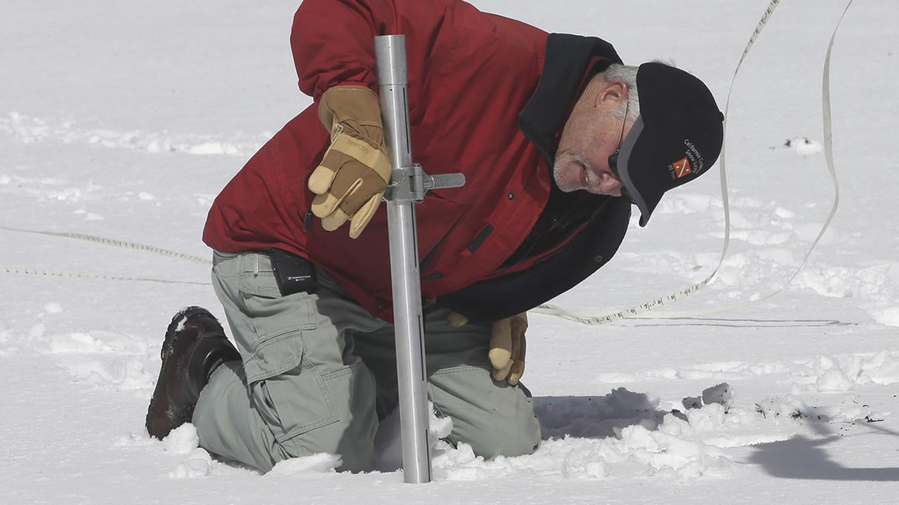 Frank Gehrke, chief of the California Cooperative Snow Surveys Program for the Department of Water Resources, performs the snow survey near Echo Summit, Calif., March 30, 2016. (AP Photo/Rich Pedroncelli)