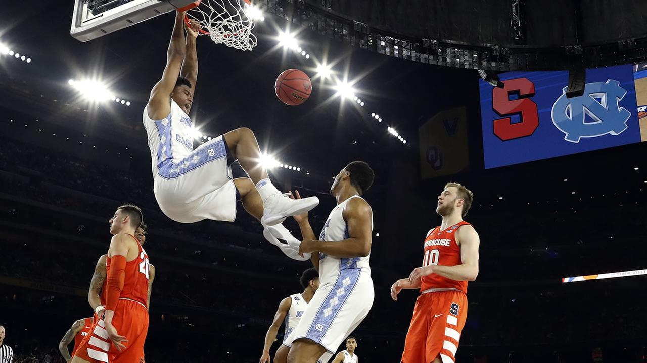 North Carolinas Isaiah Hicks (4) dunks during the NCAA Final Four tournament college basketball semifinal game against Syracuse, Saturday, April 2, 2016, in Houston.