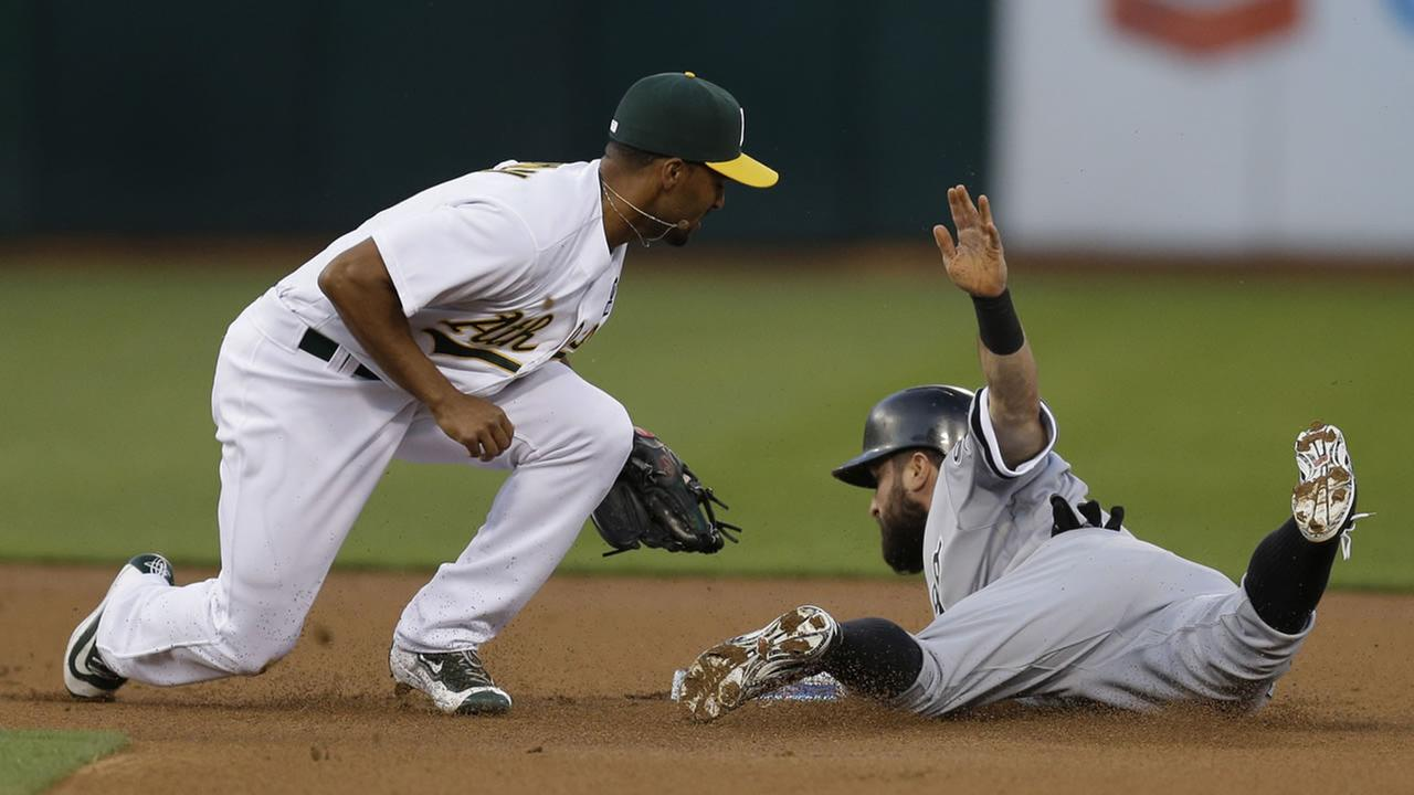 White Soxs Adam Eaton is tagged out on an attempted steal of second base by Athletics Marcus Semien during a game Monday, April 4, 2016, in Oakland, Calif. (AP Photo/Ben Margot)