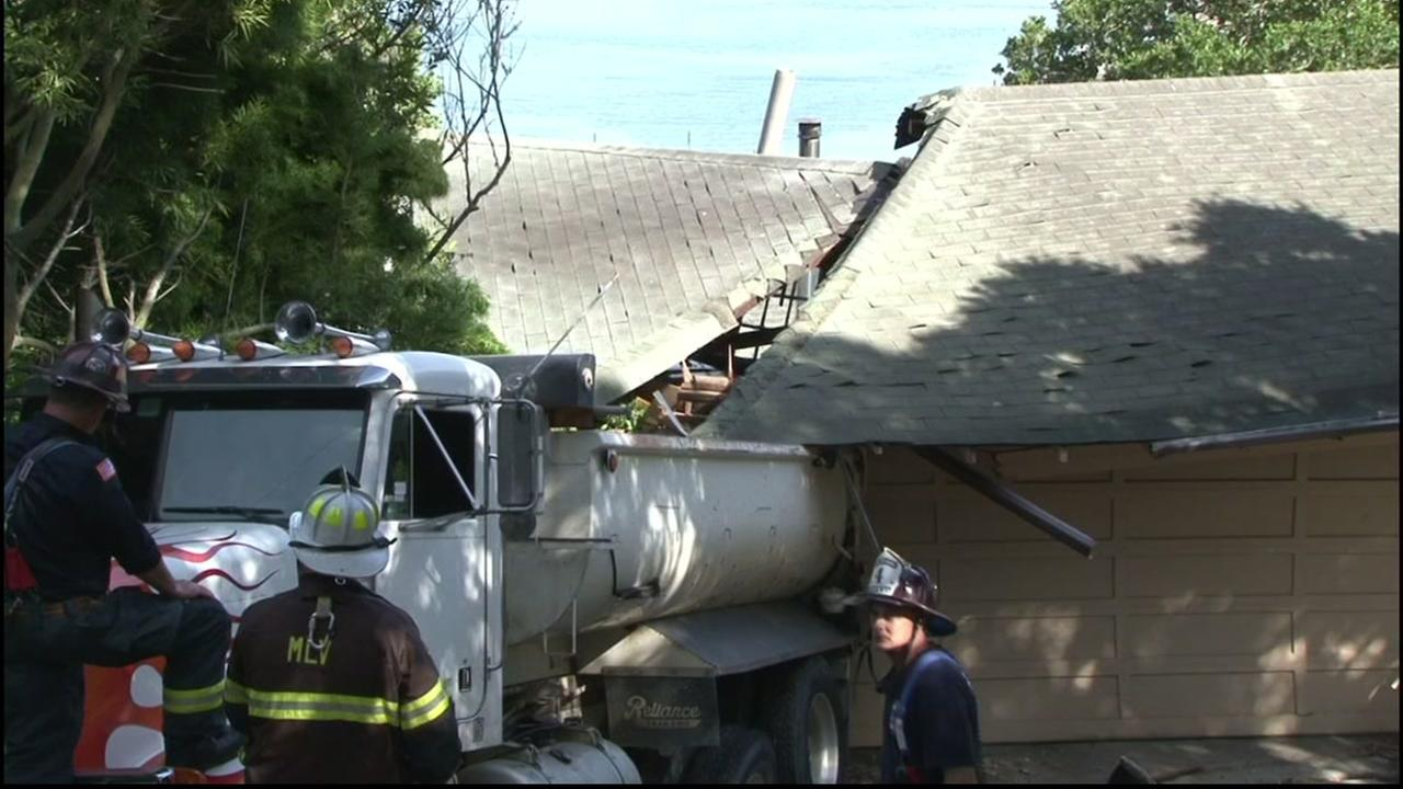 A dump truck crashed into a home in Sausalito, Calif. on Wednesday, April 6, 2016.