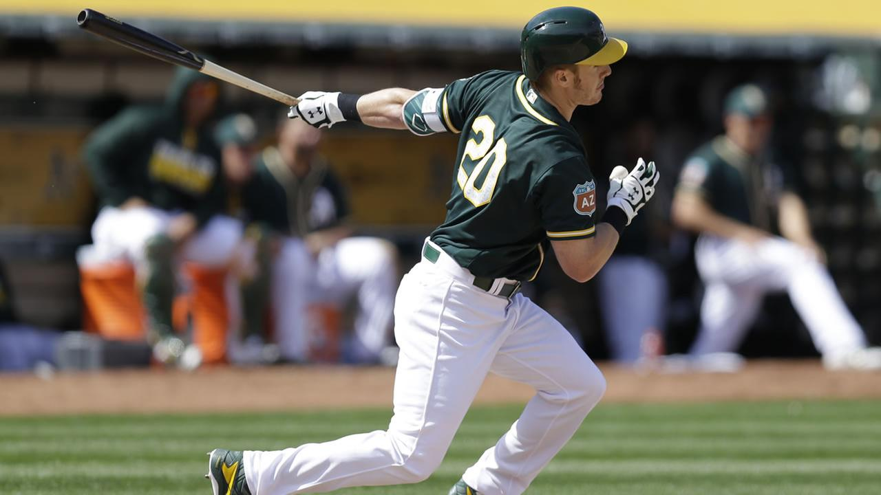 Athletics Mark Canha swings against the San Francisco Giants during an exhibition baseball game Saturday, April 2, 2016, in Oakland, Calif. (AP Photo/Ben Margot)