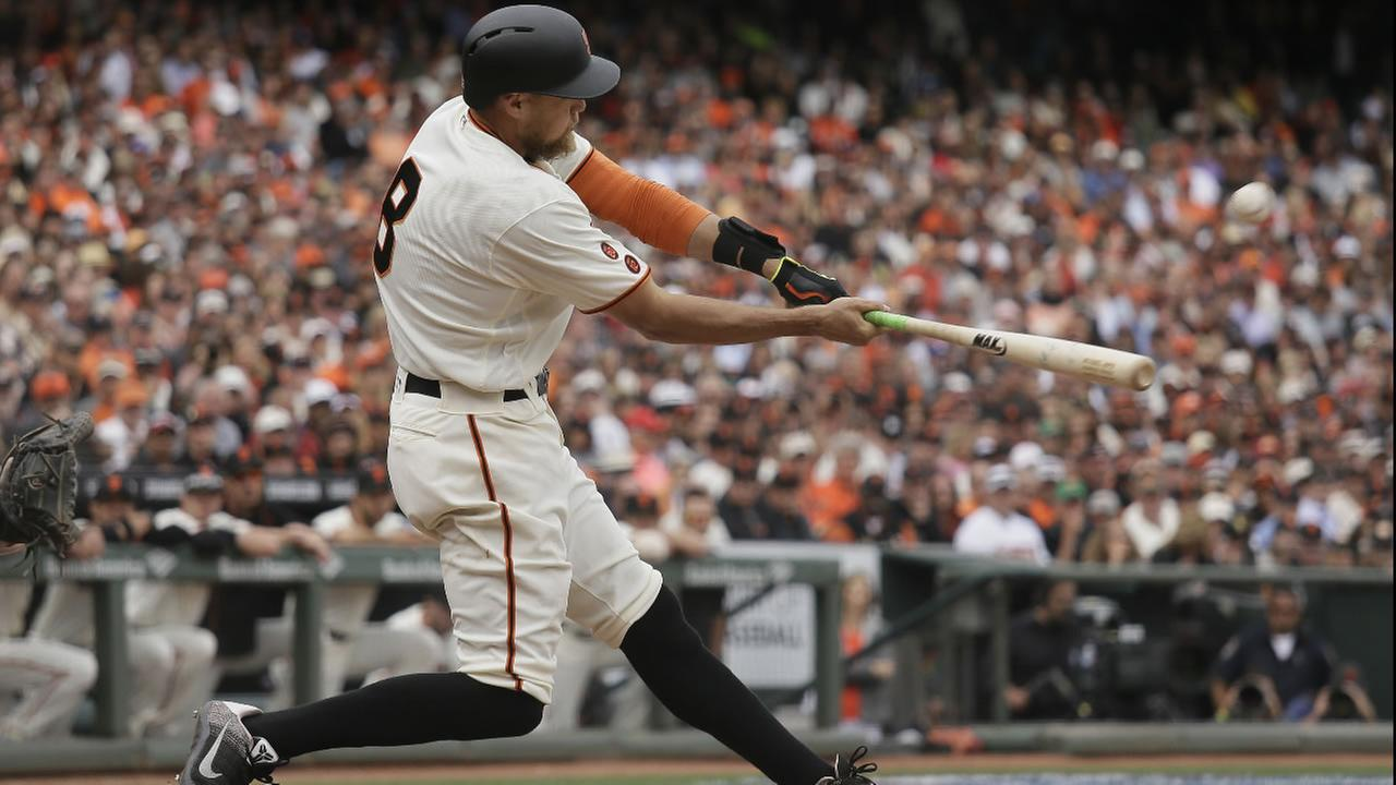 San Francisco Giants Hunter Pence hits a grand slam off Los Angeles Dodgers relief pitcher Pedro Baez in the eighth inning of a baseball game April 7, 2016, in San Francisco.