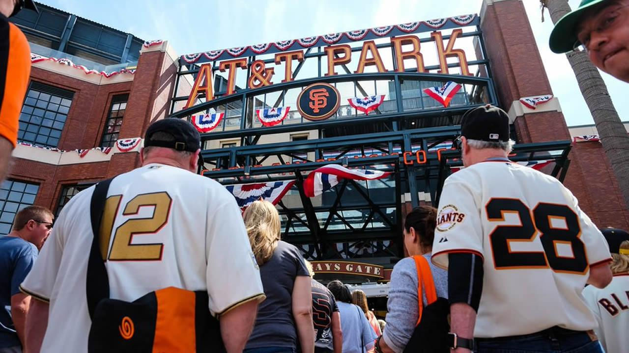 San Francisco Giants fans head to AT&T Park ahead of the teams home opener against the Los Angeles Dodgers on Thursday, April 7, 2016.