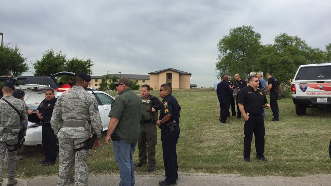 Authorities investigate shooting at Lackland Air Force base in Texas, Friday, April 8, 2016.