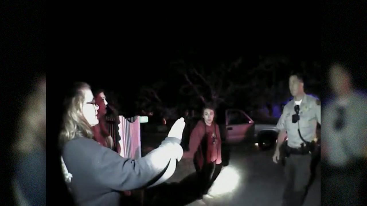 This image from body camera video shows Gabrielle Lemos and her family in June 2015 in Santa Rosa, Calif. Lemos is accusing a deputy of excessive force during her arrest.