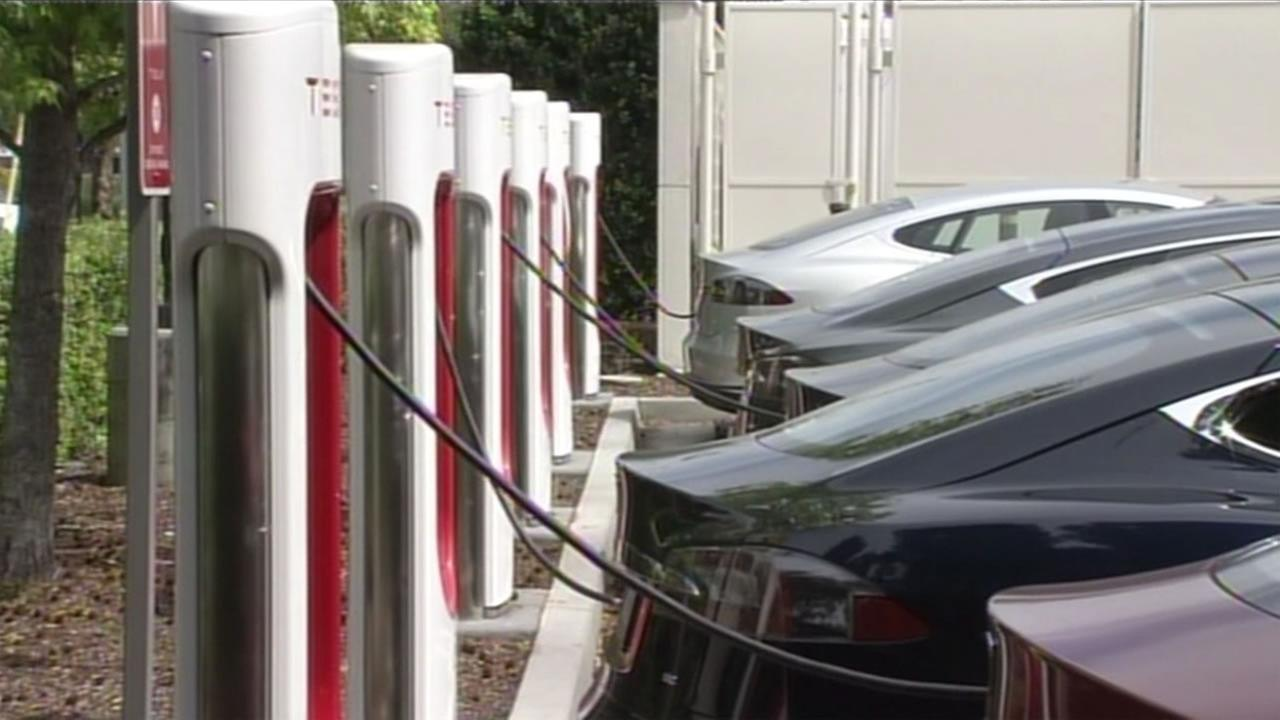 Teslas charge at stations in Mountain View, Calif. on Friday, April 8, 2016.