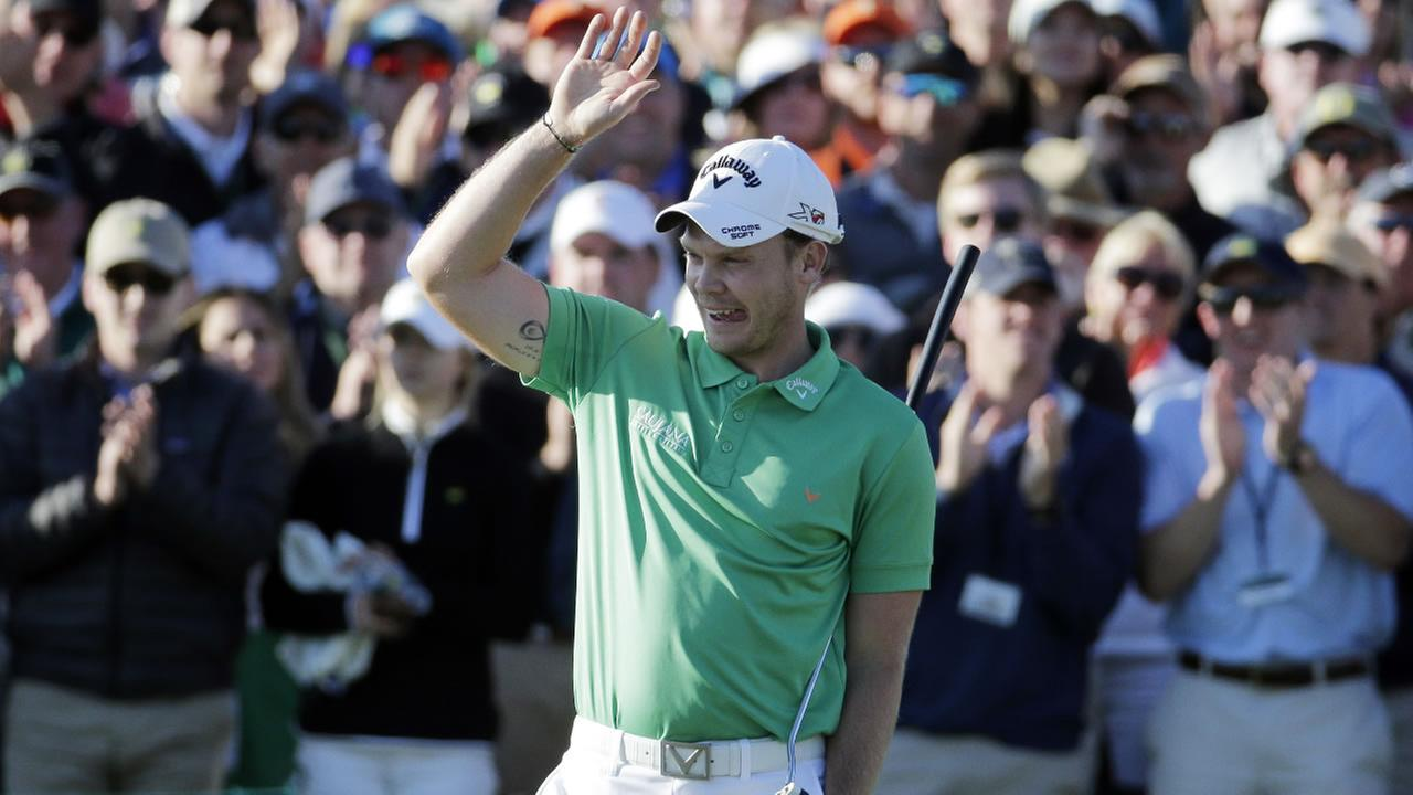 Danny Willett, of England, celebrates on the 18th hole after finishing the final round of the Masters golf tournament Sunday, April 10, 2016, in Augusta, Ga. (AP Photo)