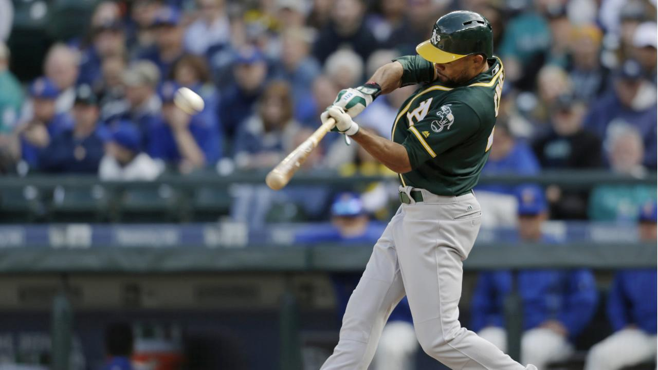 Athletics Coco Crisp hits a solo home run on a pitch from Mariners Nick Vincent during the 10th inning of a baseball game on Sunday, April 10, 2016, in Seattle. (AP Photo)
