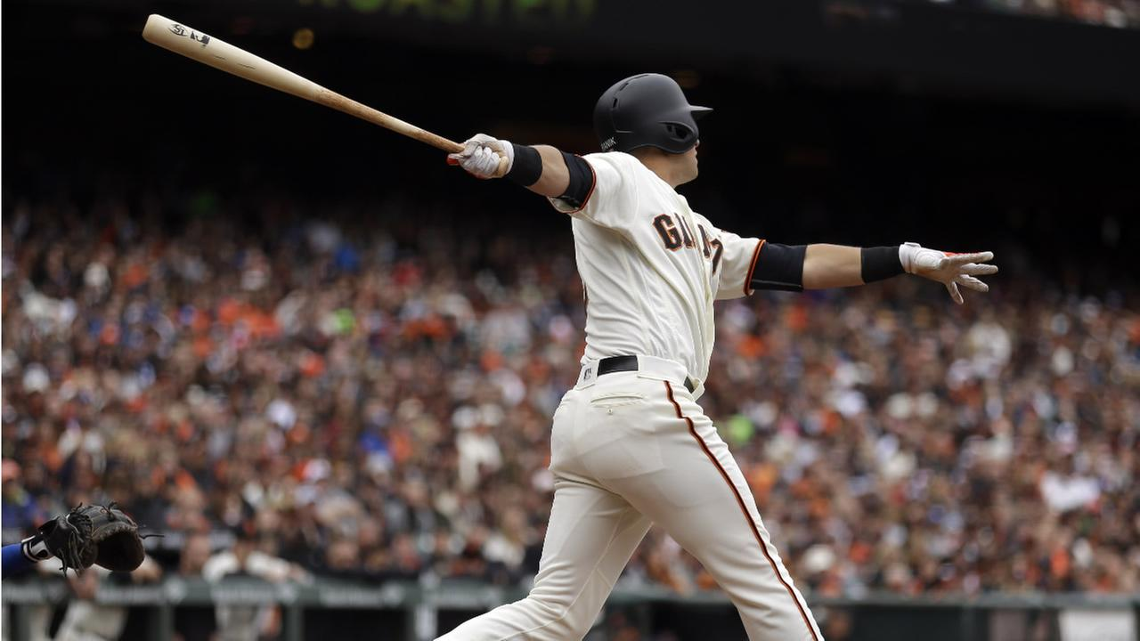 Giants Joe Panik swings for a two-run double in the sixth inning of a baseball game against the Los Angeles Dodgers, Sunday, April 10, 2016, in San Francisco. (AP Photo)