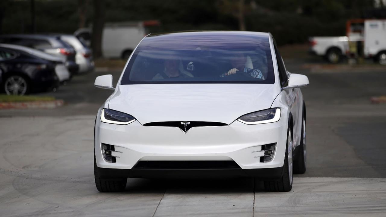 The Tesla Model X car is test driven at the companys headquarters Tuesday, Sept. 29, 2015, in Fremont, Calif.