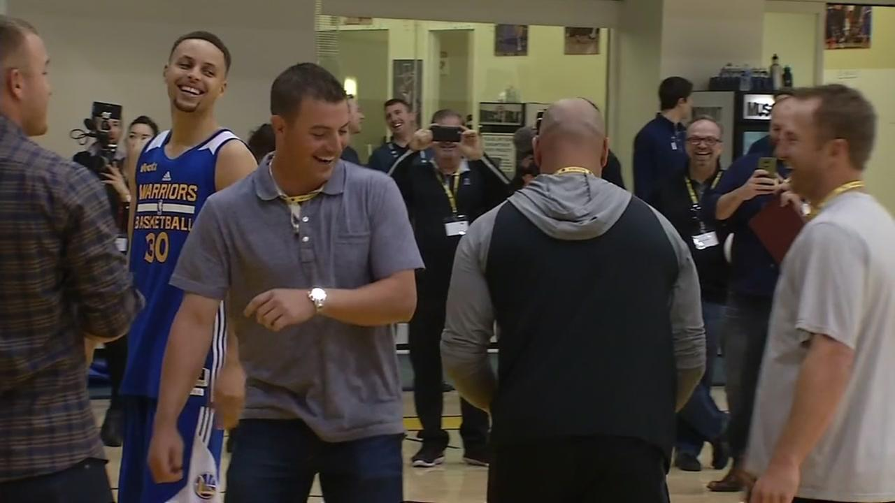 Los Angeles Angels star Mike Trout and Golden State Warriors star Steph Curry share a laugh in Oakland, Calif. on Tuesday, April 12, 2016.