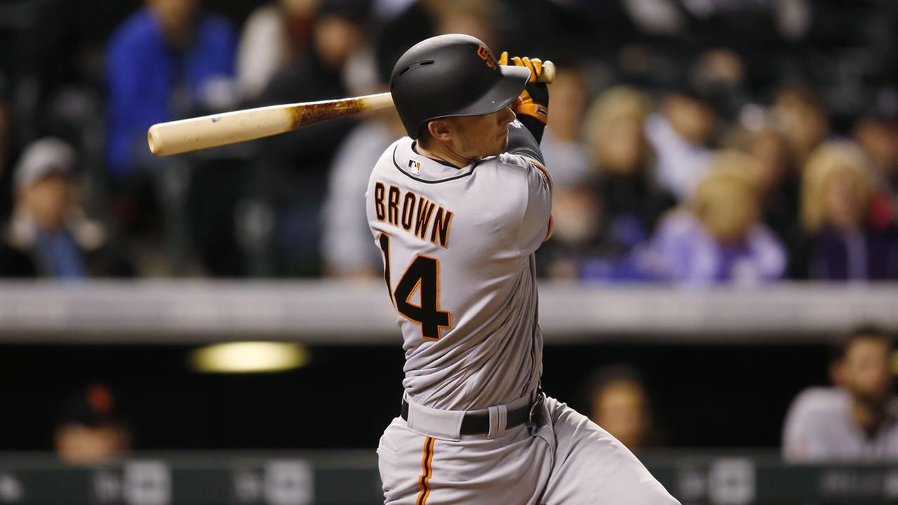 San Francisco Giants Trevor Brown watches his two-run home run off Colorado Rockies relief pitcher Jason Gurka during the eighth inning of a baseball game Tuesday, April 12, 2016.