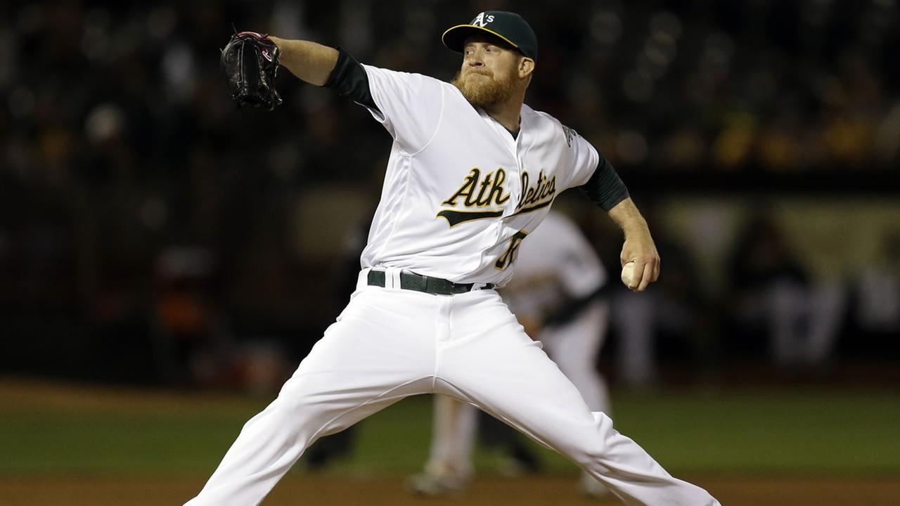 Oakland Athletics pitcher Sean Doolittle works against the Los Angeles Angels in the ninth inning of a baseball game Tuesday, April 12, 2016, in Oakland, Calif.