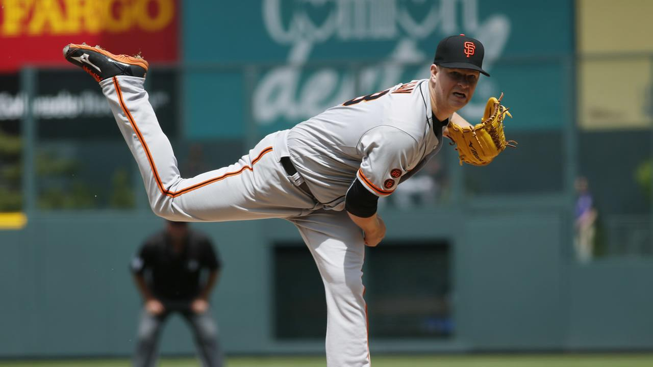 San Francisco Giants starting pitcher Matt Cain works against the Colorado Rockies in the first inning of a baseball game Thursday, April 14, 2016, in Denver.