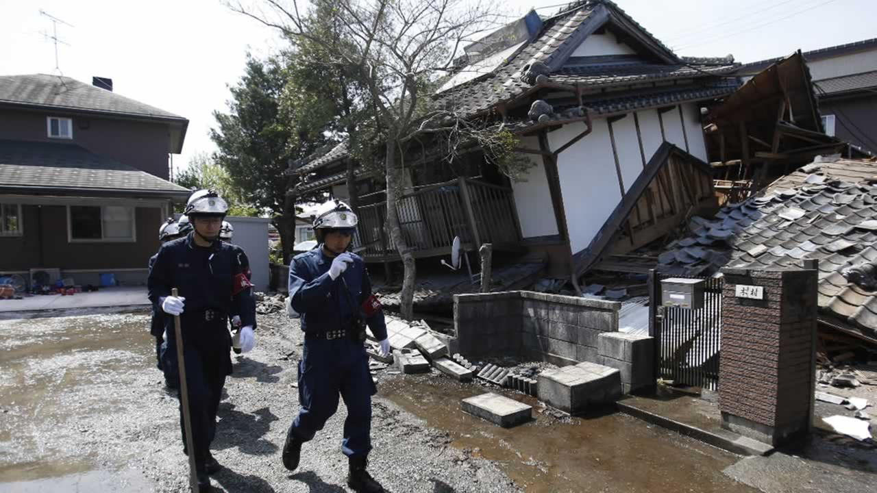 Police officers search for people possibly trapped at damaged houses in Mashiki, Kumamoto prefecture, southern Japan, Friday, April 15, 2016.AP Photo/Koji Ueda