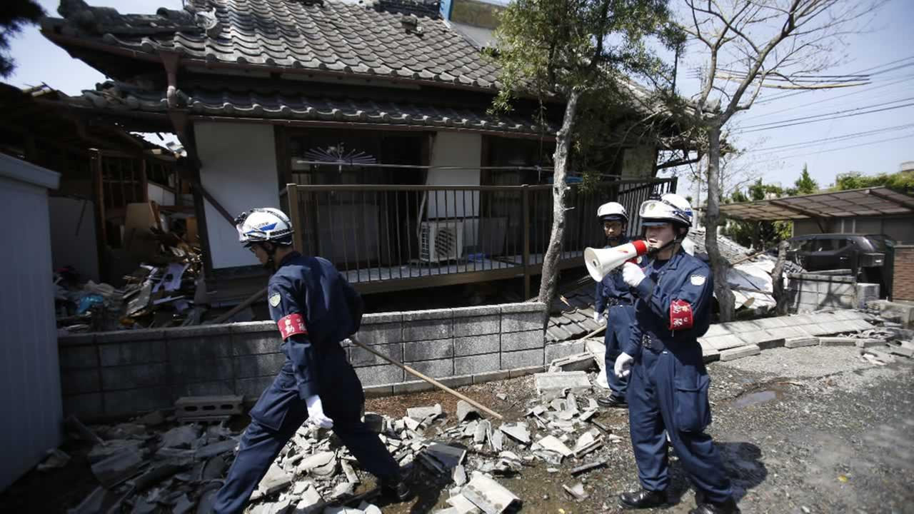 Police officers search for people possibly trapped at a damaged home in Mashiki, Kumamoto prefecture, southern Japan, Friday, April 15, 2016.AP Photo/Koji Ueda