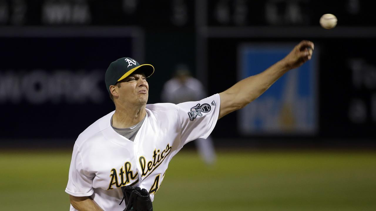 Oakland Athletics starting pitcher Rich Hill throws to the Kansas City Royals during the third inning of a baseball game Friday, April 15, 2016, in Oakland, Calif.