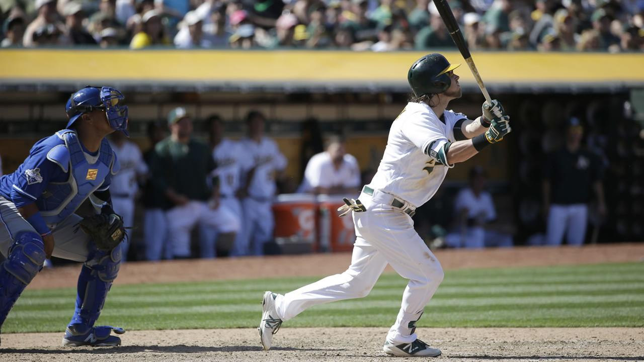 Athletics Josh Reddick drives in the go-ahead run with a sacrifice fly ball during the eighth inning of a baseball game, Sunday, April 17, 2016, in Oakland, Calif. (AP Photo)