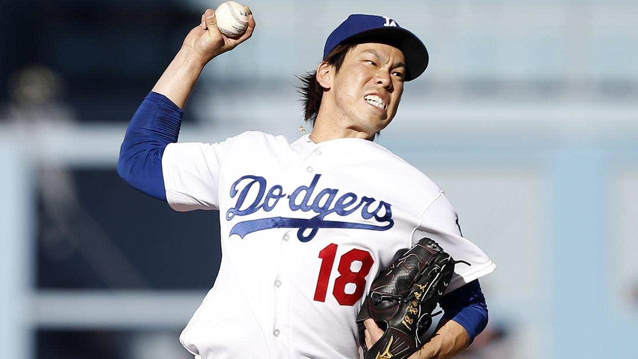 Dodgers starting pitcher Kenta Maeda throws against the Giants during the first inning of a baseball game in Los Angeles, Sunday, April 17, 2016. (AP Photo/Alex Gallardo)