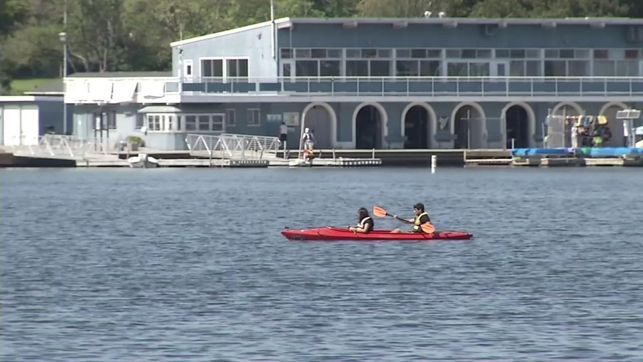 Two people kayak on a hot day at Lake Merritt in Oakland, Calif. on Monday, April 18, 2016.