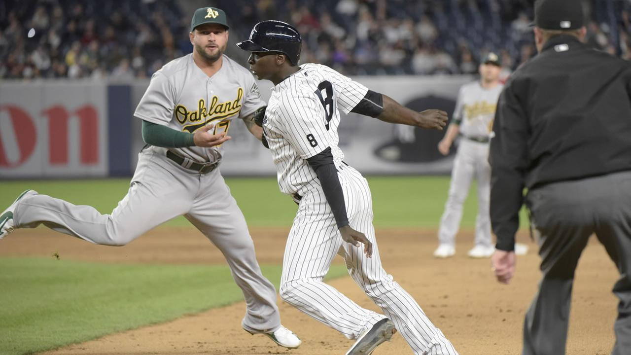 Yankees Didi Gregorius is tagged out by Athletics Yonder Alonso after being caught in a rundown during a game on April 19, 2016, at Yankee Stadium in New York. (AP Photo)