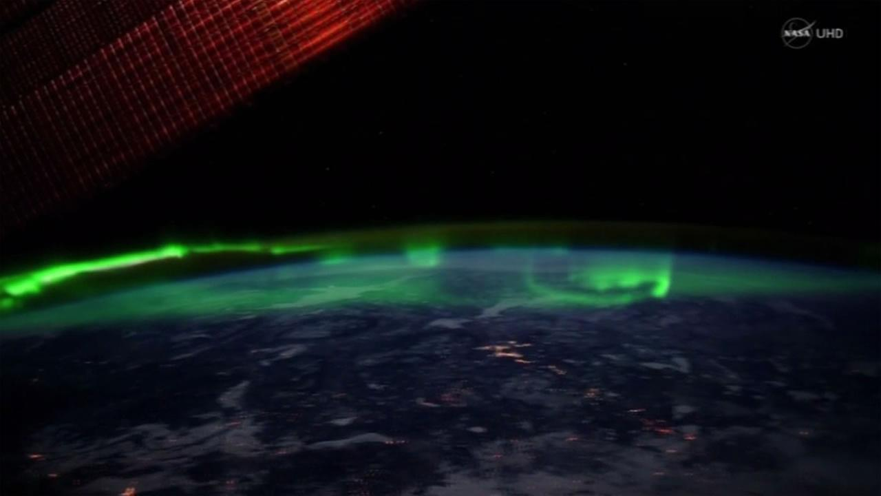 This is an image taken by NASA in space of the aurora borealis.