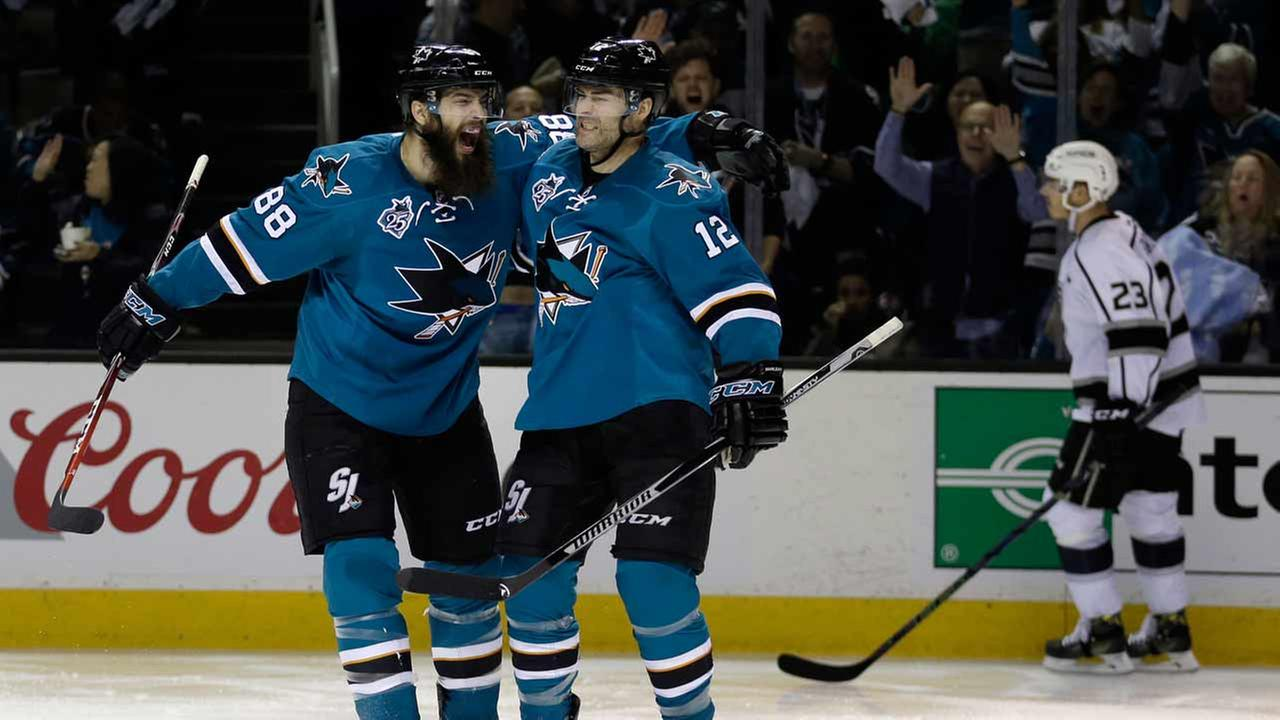 San Jose Sharks Patrick Marleau, right, celebrates with Brent Burns (88) after scoring a goal against the Los Angeles Kings, Wednesday, April 20, 2016.