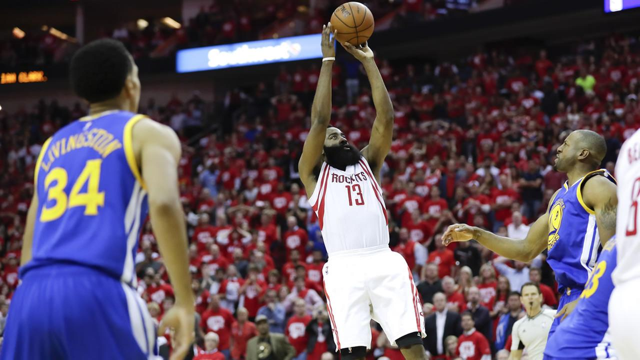 Rockets guard James Harden scores the winning basket during Game 3 of their playoff series against the Warriors in Houston on April 21, 2016. (AP Photo/David J. Phillip)