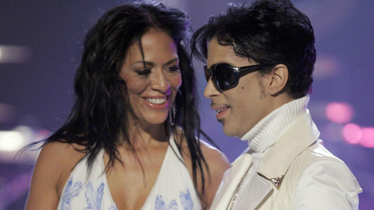 Prince leaves the stage with Sheila E after performing during the 2007 National Council of La Raza ALMA Awards in Pasadena, Calif. Friday, June 1, 2007.