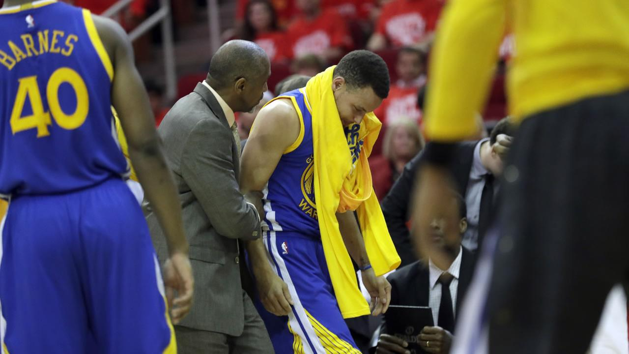 Golden State Warriors Stephen Curry heads off the court after being injured in Game 4 of a first-round NBA basketball playoff series against the Houston Rockets, Sunday, April 24, 2016, in Houston.