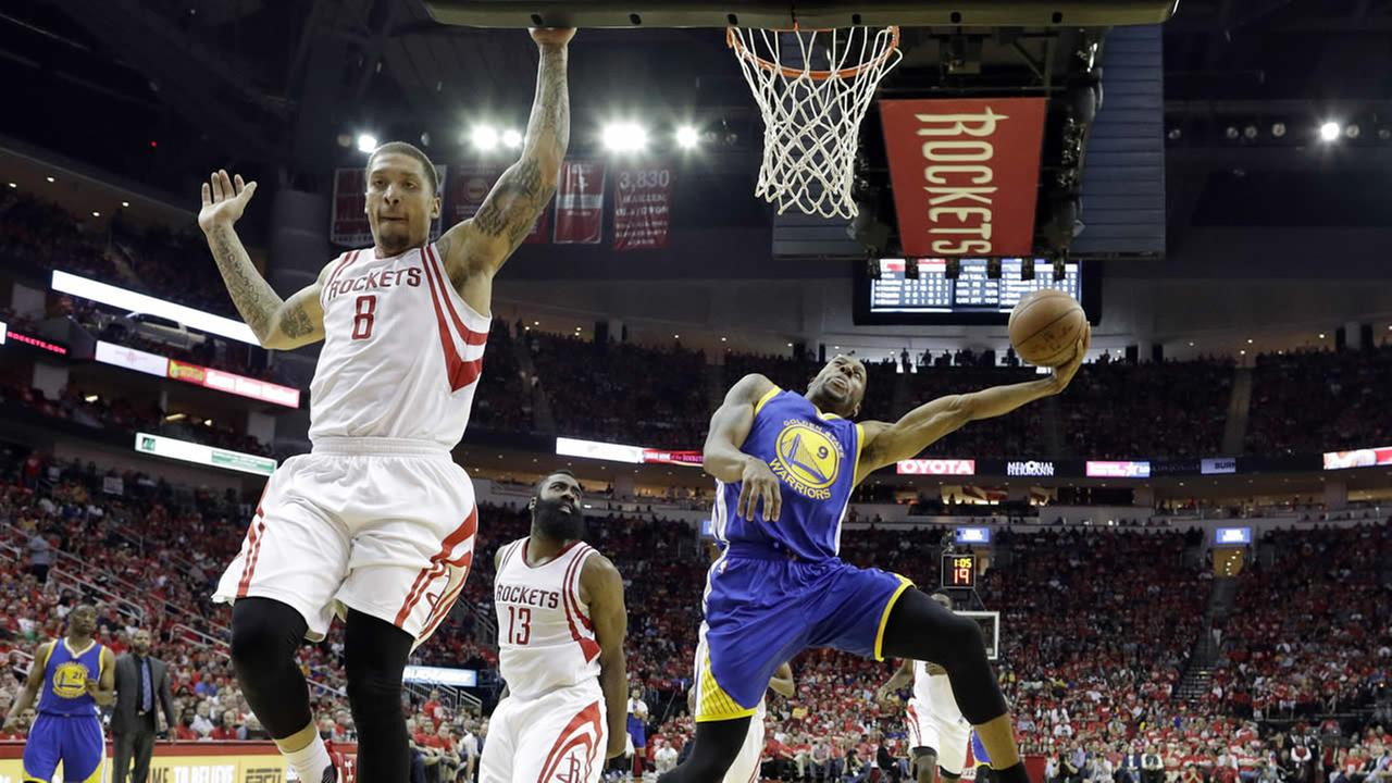 Warriors Andre Iguodala shoots over Rockets Michael Beasley in Game 4 of a first-round NBA basketball playoff series, Sunday, April 24, 2016, in Houston. (AP Photo)
