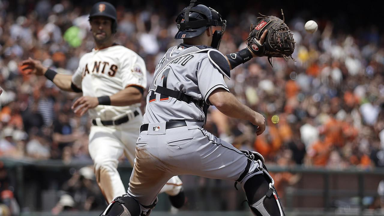 Marlins catcher J.T. Realmuto waits for the ball to tag out Giants Angel Pagan at home plate during a baseball game April 24, 2016, in San Francisco. (AP Photo/Ben Margot)