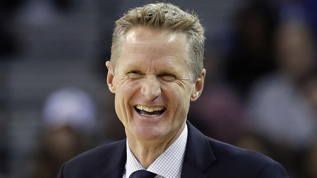 In this March 23, 2016 file photo, Golden State Warriors coach Steve Kerr smiles as his team plays the Los Angeles Clippers during a game in Oakland, Calif. (AP Photo/Marcio Jose Sanchez, File)
