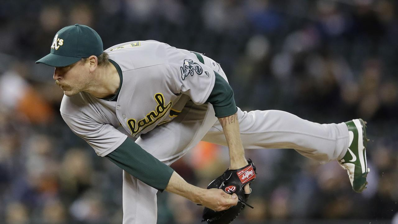Oakland Athletics relief pitcher John Axford throws during the ninth inning of a baseball game against the Detroit Tigers, Tuesday, April 26, 2016, in Detroit.