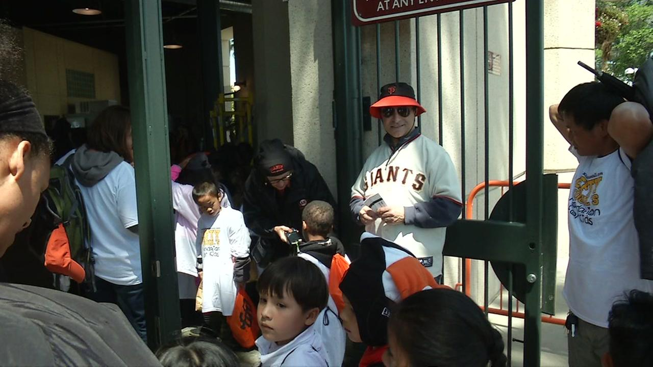 Lefty ODouls owner Nick Bovis hands out San Francisco Giants tickets to students on Wednesday, April 27, 2016.