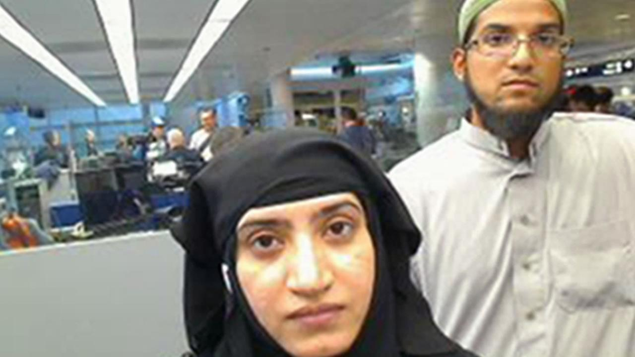 This July 27, 2014, file photo provided by U.S. Customs and Border Protection shows Tashfeen Malik, left, and Syed Farook, as they passed through OHare Airport in Chicago.