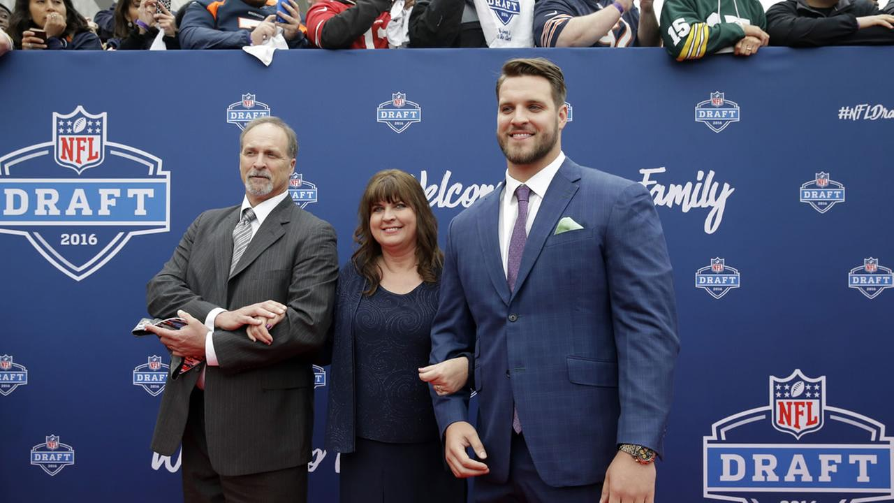 Ohio States Taylor Decker, right, poses for photos at the 2016 NFL football draft at the Auditorium Theater of Roosevelt University, April 28, 20616 in Chicago.