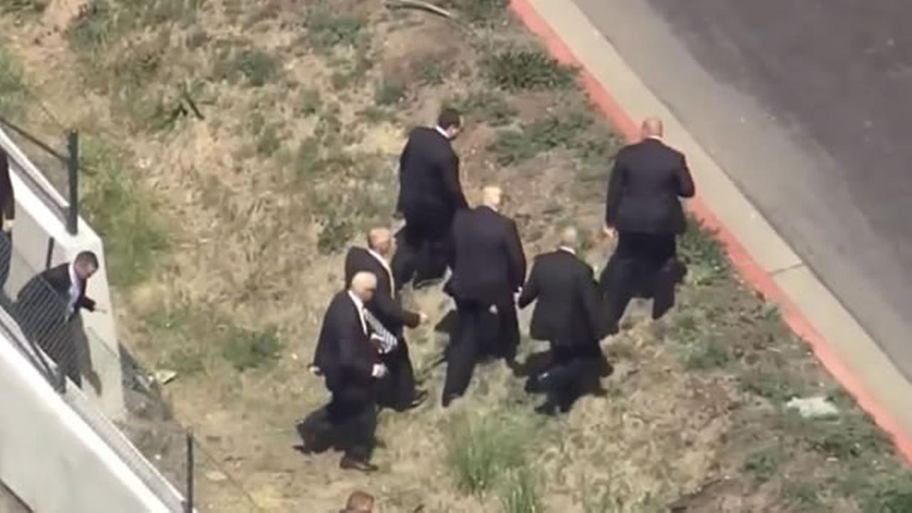 Donald Trump crosses freeway to avoid protesters in order to enter Hyatt Regency in Burlingame, Calif. on Friday, APril 29, 2016.KGO-TV