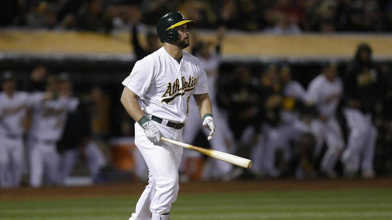 Oakland Athletics Yonder Alonso watches his three-run home run against the Houston Astros in the ninth inning of a baseball game Friday, April 29, 2016, in Oakland, Calif.