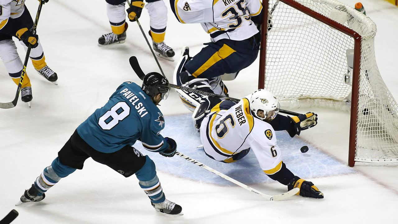 Sharks Joe Pavelski scores a goal past Predators Shea Weber during Game 2 in an NHL hockey Western Conference semifinal series on May 1, 2016, in San Jose, Calif. (AP Photo)