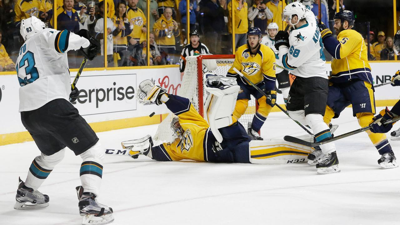 Nashville Predators goalie Pekka Rinne, of Finland, dives for a shot by San Jose Sharks left wing Matt Nieto (83) on Tuesday, May 3, 2016, in Nashville, Tenn.