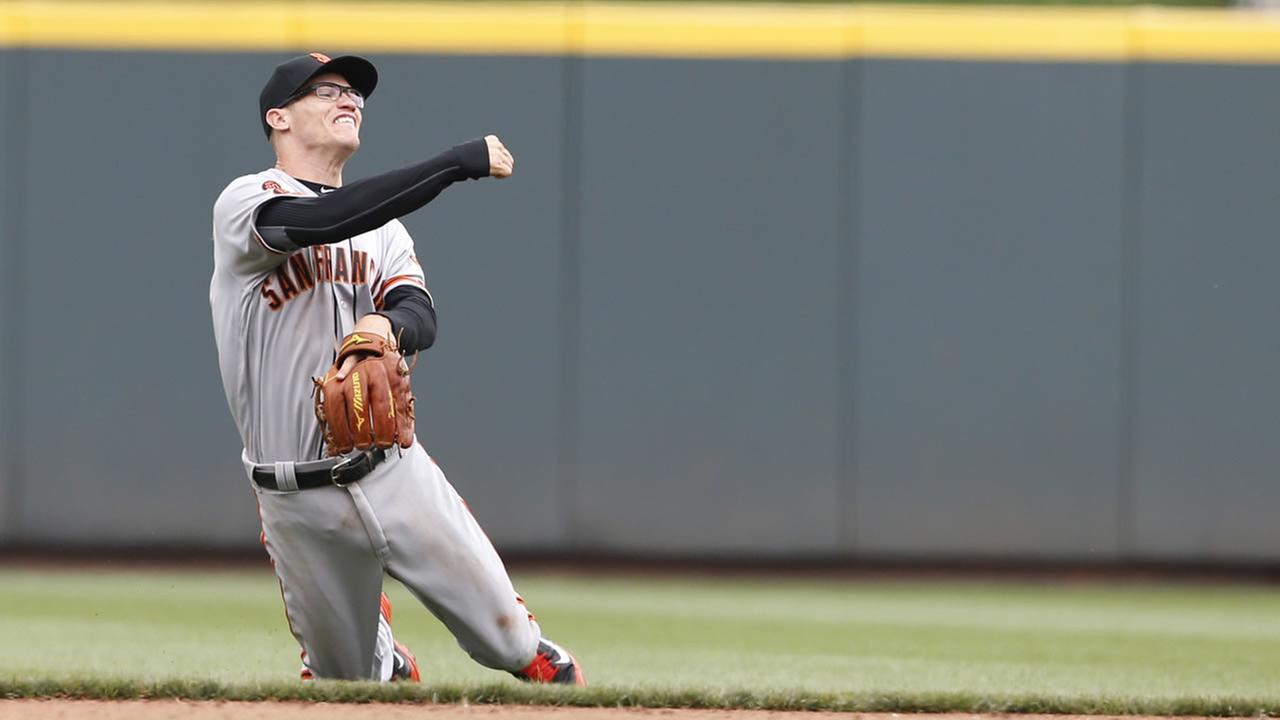 San Francisco Giants second baseman Kelby Tomlinson (37) throws from his knees during a baseball during the eighth inning of a baseball game, Wednesday, May 4, 2016, in Cincinnati.