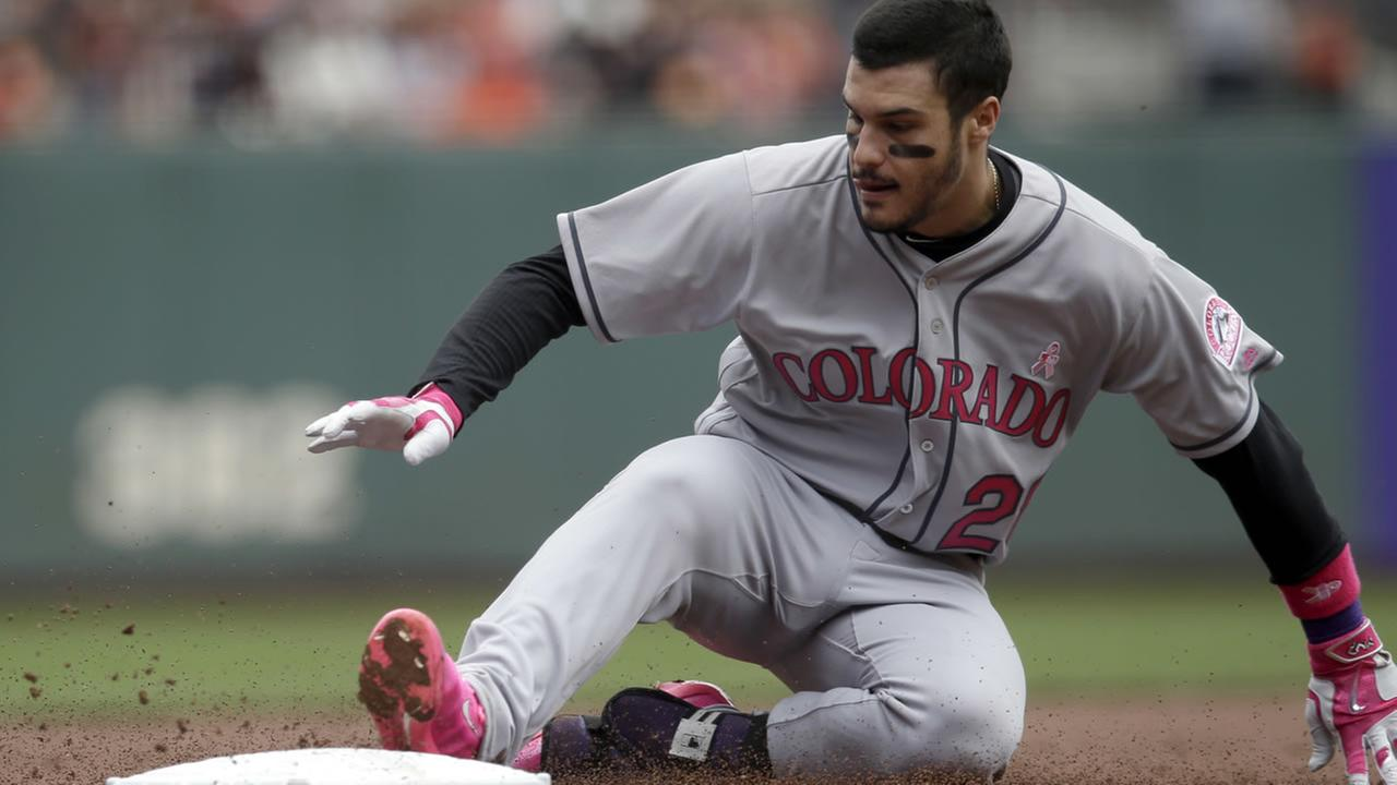 Rockies Nolan Arenado (28) slides safely into third base with an RBI-triple during a game against the Giants on Sunday, May 8, 2016. (AP Photo/Marcio Jose Sanchez)