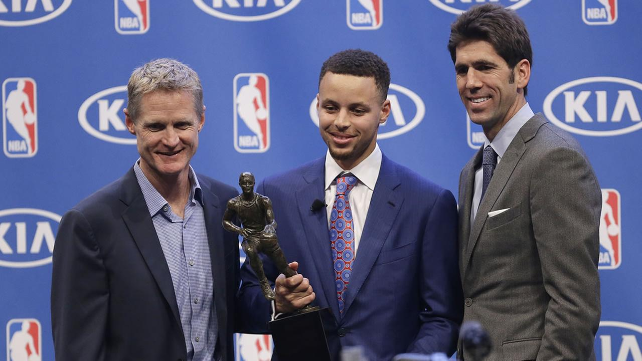 Warriors coach Steve Kerr, Stephen Curry, and GM Bob Myers pose during the NBAs Most Valuable Player award presentation on May 10, 2016, in Oakland, Calif. (AP Photo/Ben Margot)AP Photo/Ben Margot