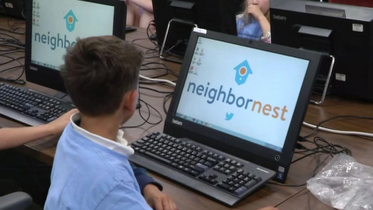 This image shows a child at the Neighbor Nest May 10, 2016, in San Francisco, a safe haven for low-income and homeless residents to learn about technology and gain job skills.