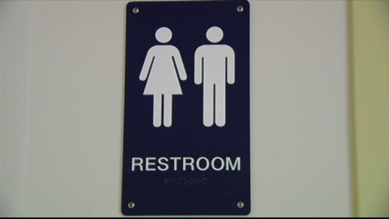 Sign shows that bathroom allows both male and female occupants.