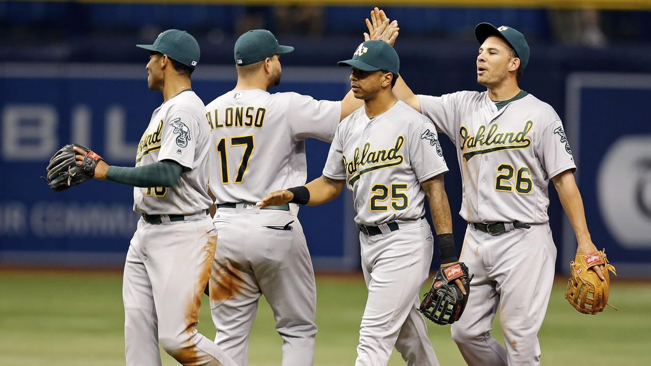 Members of the Oakland AthleticsMarcus Semien, Yonder Alonso, Tyler Ladendorf and Danny Valencia celebrate a win over the Tampa Bay Rays in a baseball game Friday May 14, 2016.